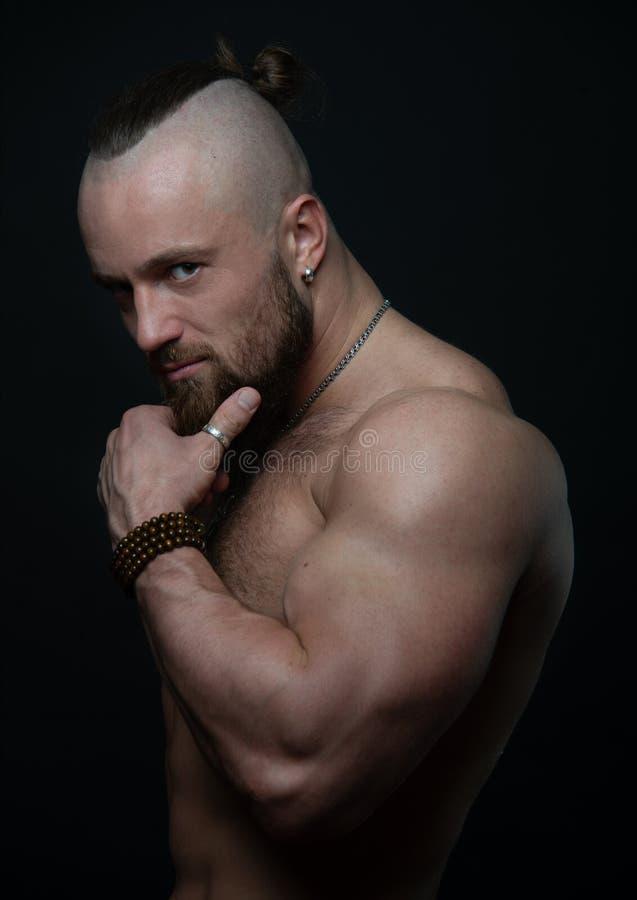 Portrait of bodybuilder. Portrait of muscular man posing in studio royalty free stock image
