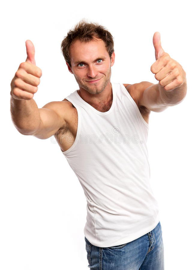 Portrait of a muscular young man, thumbs up stock image