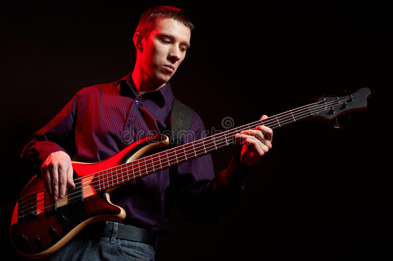 Portrait of musician with bass guitar royalty free stock photos