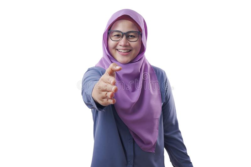 Muslim Businesswoman Offering Hand Shake. Portrait of muslim businesswoman offers hand shake, deal partnership agreeement concept, selective focus image, asian stock image