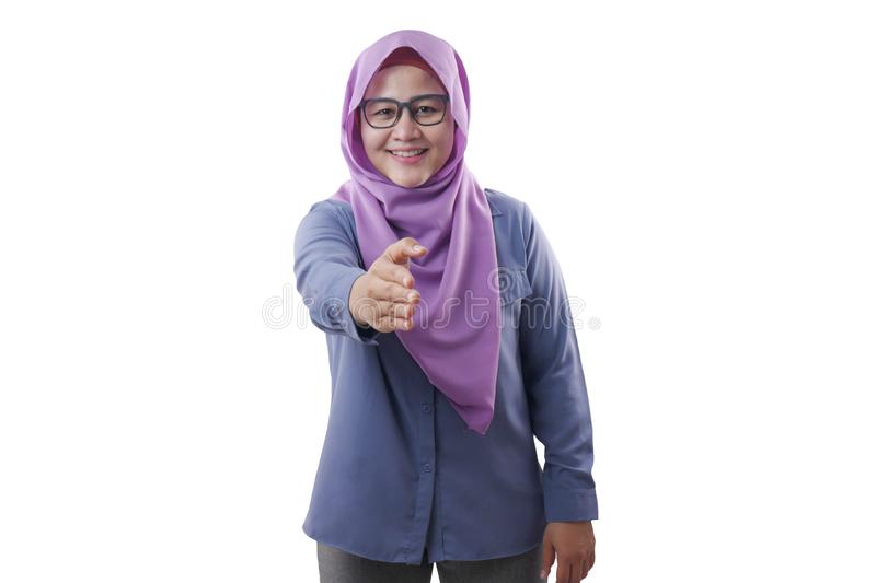 Muslim Businesswoman Offering Hand Shake. Portrait of muslim businesswoman offers hand shake, deal partnership agreeement concept, selective focus image, asian stock photos