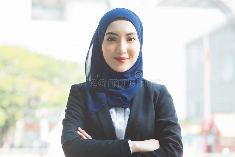 Muslim woman in business suit stock images