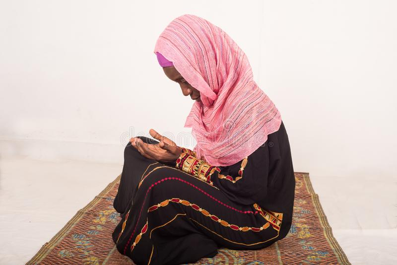Portrait of praying muslim woman, indoors stock images