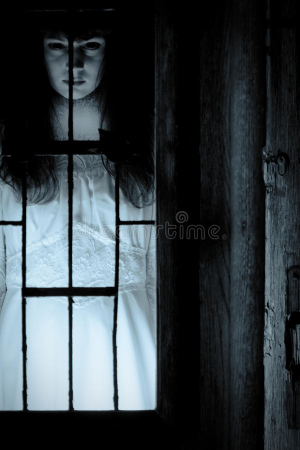 Portrait of mysterious woman in white dress. Horror scene of a scary woman royalty free stock photos