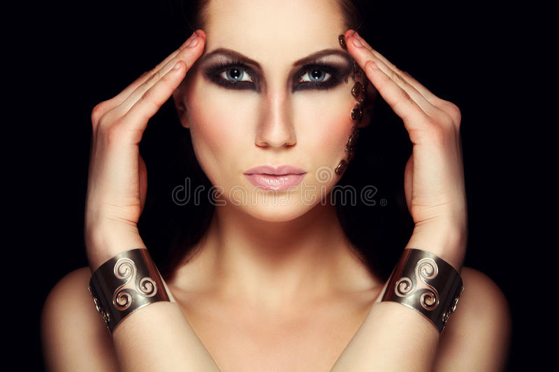 Portrait of mystic woman with extravagant makeup. Portrait of mystic woman with extravagant make up. Retouched royalty free stock photography