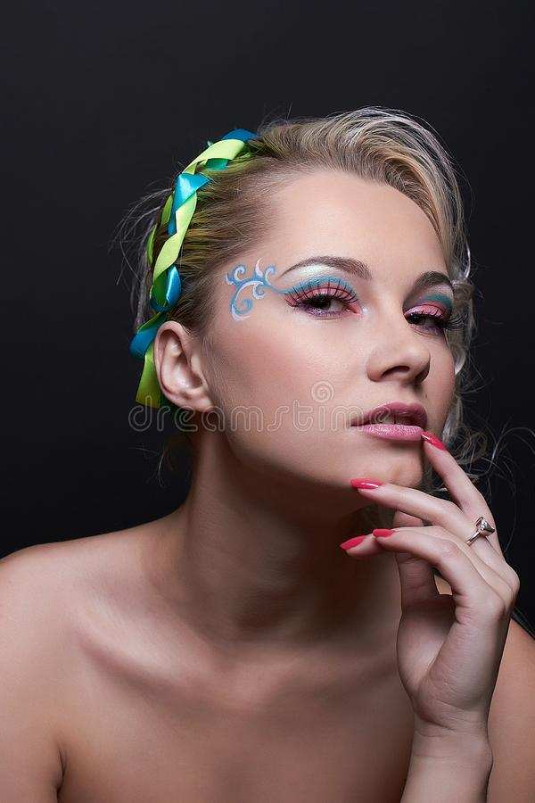 Portrait of naked blonde model girl with creative makeup, bright colorful eyeshadows and pink lipstick, isolated at the royalty free stock photography