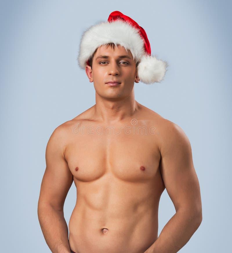 Portrait Of Naked Male In Santa Cap Stock Image - Image of