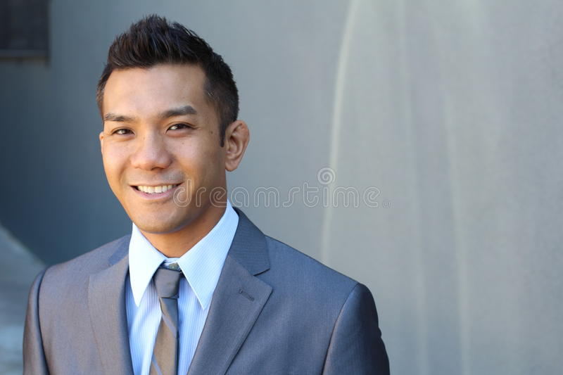 Portrait of a natural handsome classic Asian male with copy space on the right stock images