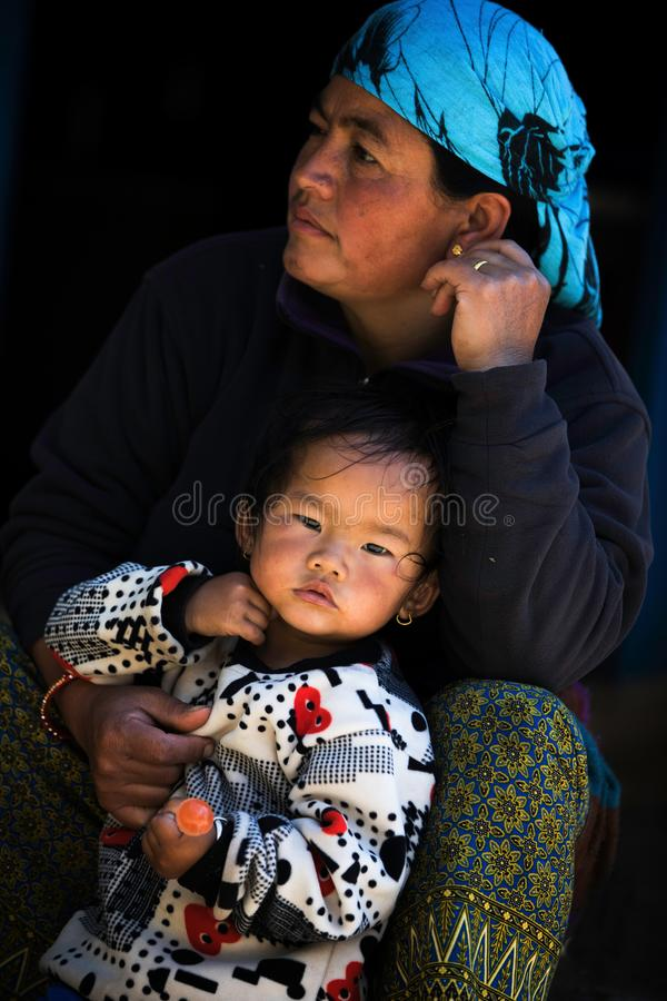 Portrait nepalese mother and child. In a village, Annapurna Circuit, Nepal royalty free stock images