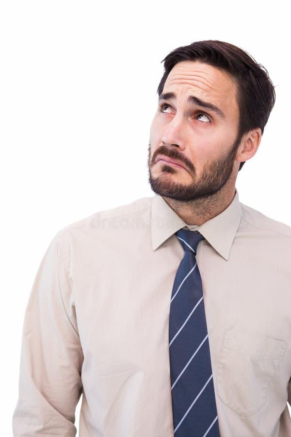 Portrait of a nervous businessman looking up stock images