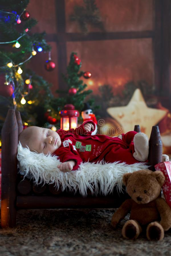 Portrait of newborn baby in Santa clothes in little baby bed stock image