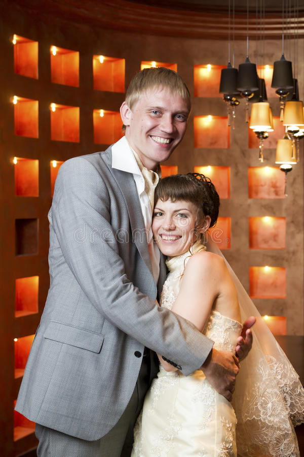 Portrait of newlyweds. In interior royalty free stock images