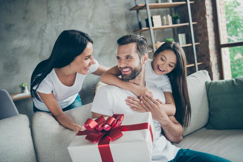 Portrait of nice attractive lovely adorable charming tender sweet cheerful cheery careful family wearing casual white t. Portrait of nice attractive lovely stock images