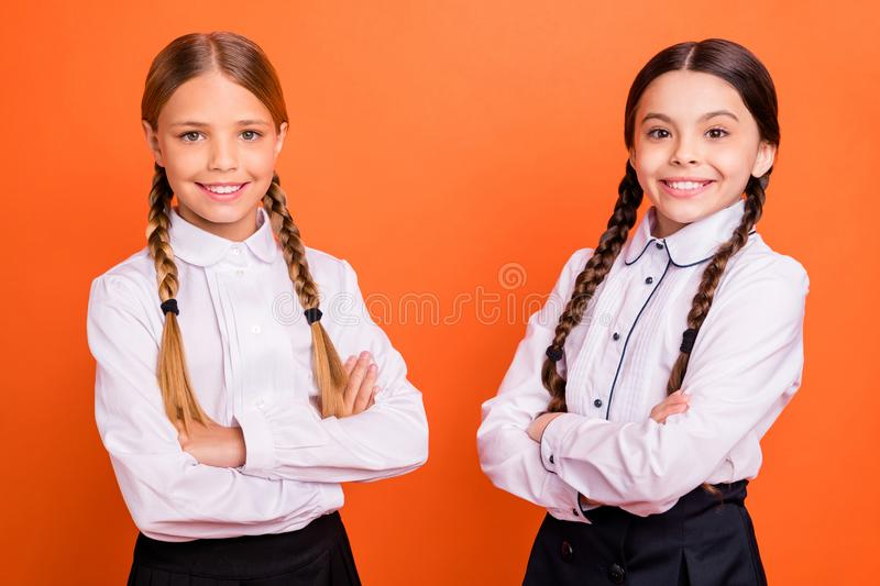 Portrait of nice attractive lovely charming confident cheerful cheery positive pre-teen girls folded arms isolated over. Portrait of nice attractive lovely royalty free stock photos