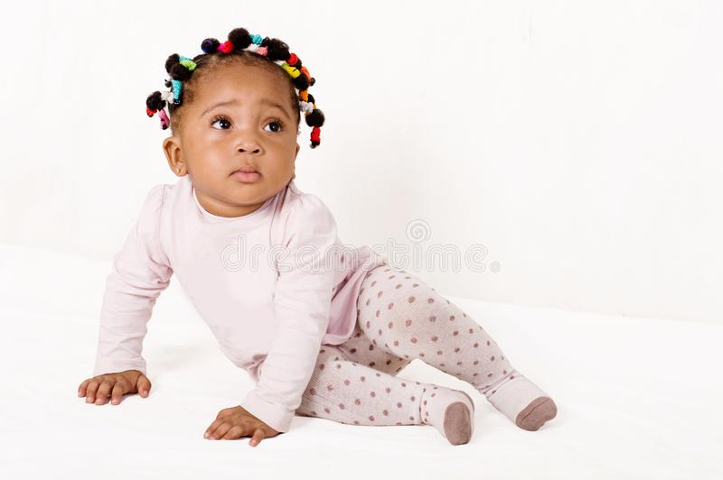 Portrait of a nice baby looking up. royalty free stock image