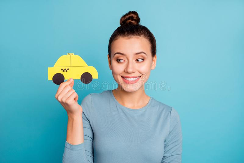 Portrait of nice charming beautiful top-knot lady hold hand paper car yellow taxi cab look show gesture glad positive royalty free stock photography