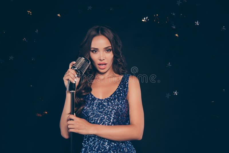 Portrait of nice confident content calm professional singer diva. Adorable charming attractive winsome sweet lovely wavy-haired lady loud music nightclub royalty free stock photo