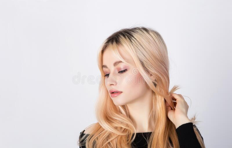 Portrait of a nice and cute blonde model with natural and soft makeup stock photo