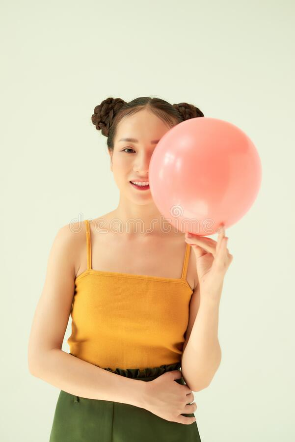 Portrait of nice cute lovable adorable attractive lovely cheerful cheery positive girl holding air baloon.  stock image