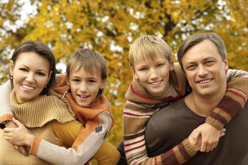 Nice family relaxing in autumn stock images
