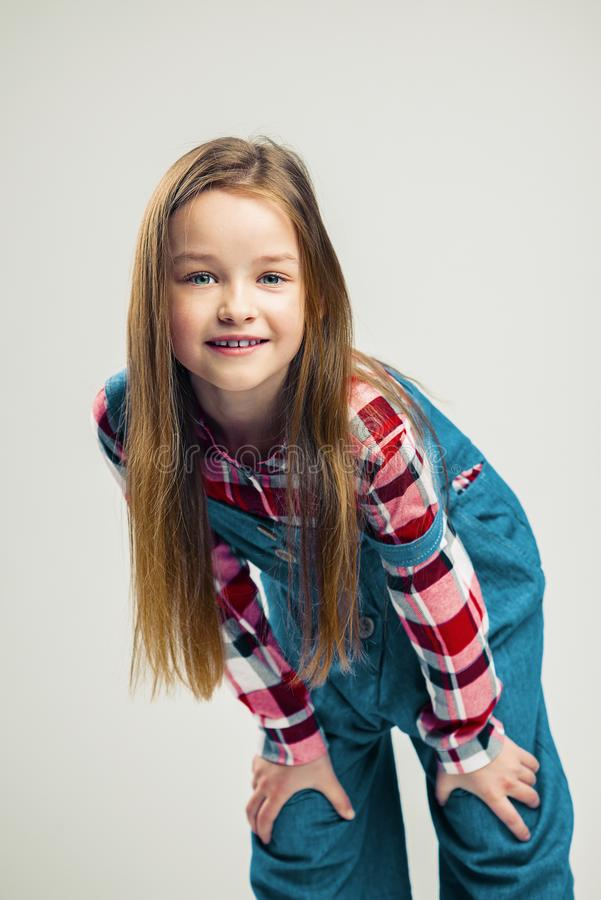 Portrait of a nice little girl. kid smiles. child model posing in the studio. fashion photography stock photo