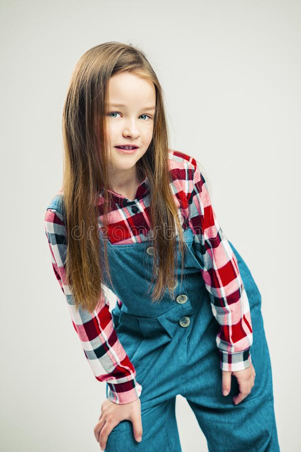 Portrait of a nice little girl. kid smiles. child model posing in the studio. fashion photography stock photos