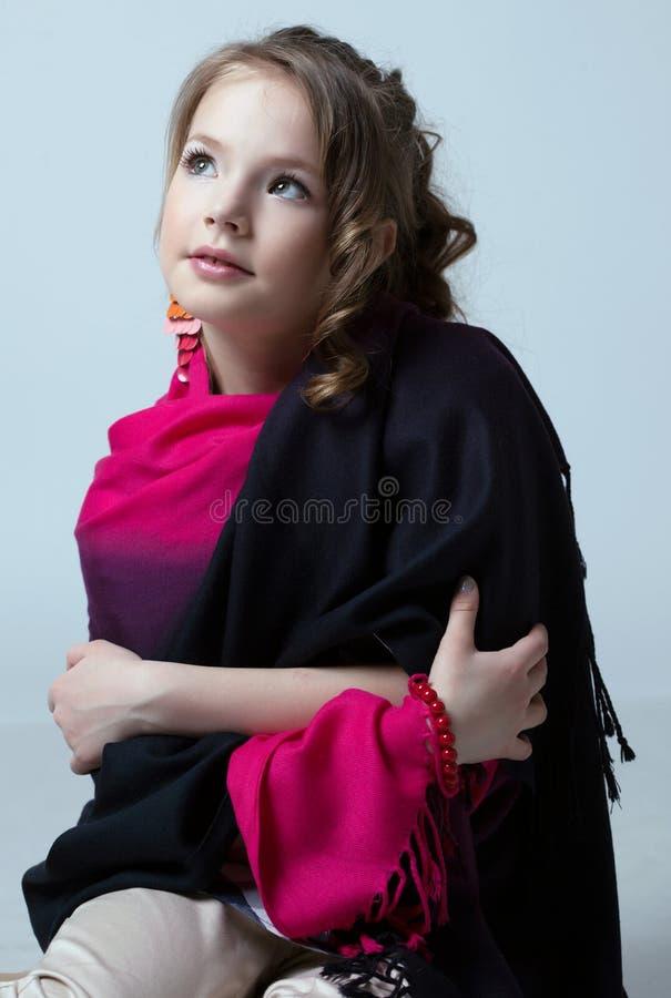 Portrait of nice little model posing in studio. Close-up stock image