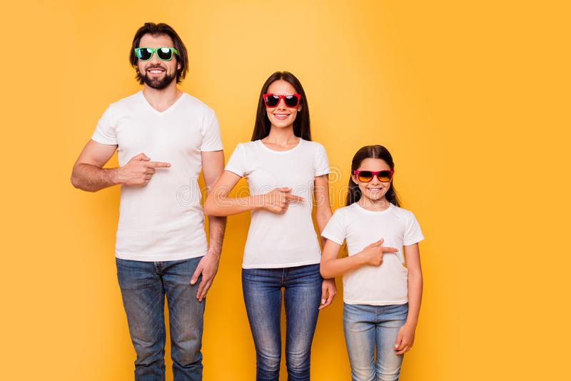 Portrait of nice-looking attractive charming trendy cheerful people wearing colorful modern eyewear hierarchy order. Pointing aside over shine vivid pastel stock photography