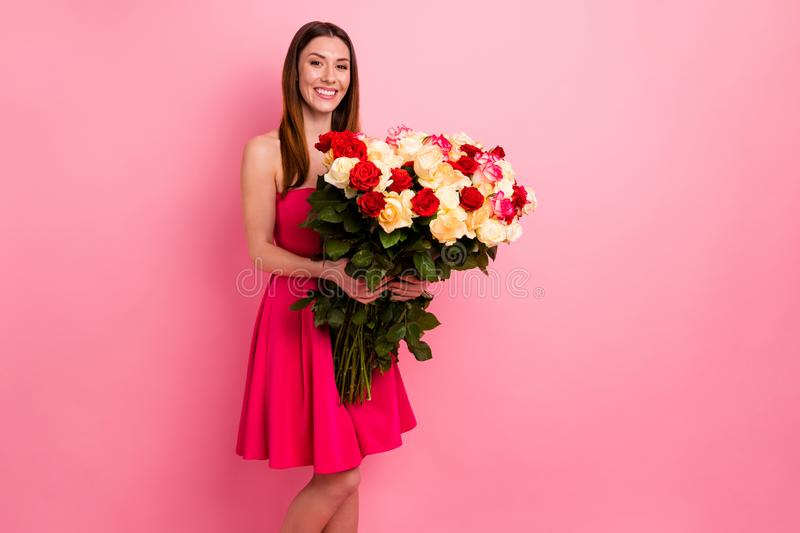Portrait of nice-looking attractive lovely pretty cheerful glad red haired girl holding in hands big large huge bouquet. Portrait of nice-looking attractive royalty free stock photography