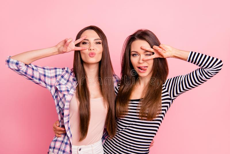 Portrait of nice-looking attractive lovely winsome flirty cheerful cheery straight-haired girls wearing casual showing v royalty free stock photography