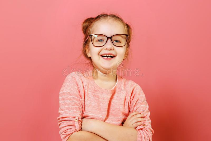 Portrait of nice-looking cute adorable cheerful cheery content modern little child girl folded arms in glasses royalty free stock photography