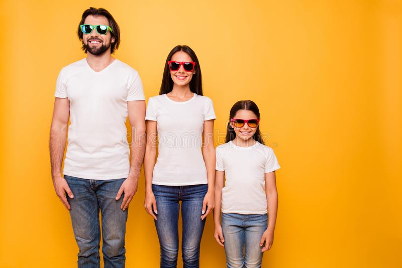Portrait of nice lovely attractive charming cheerful cheery people wearing colorful modern eyewear hierarchy order. Over shine vivid pastel yellow background stock images