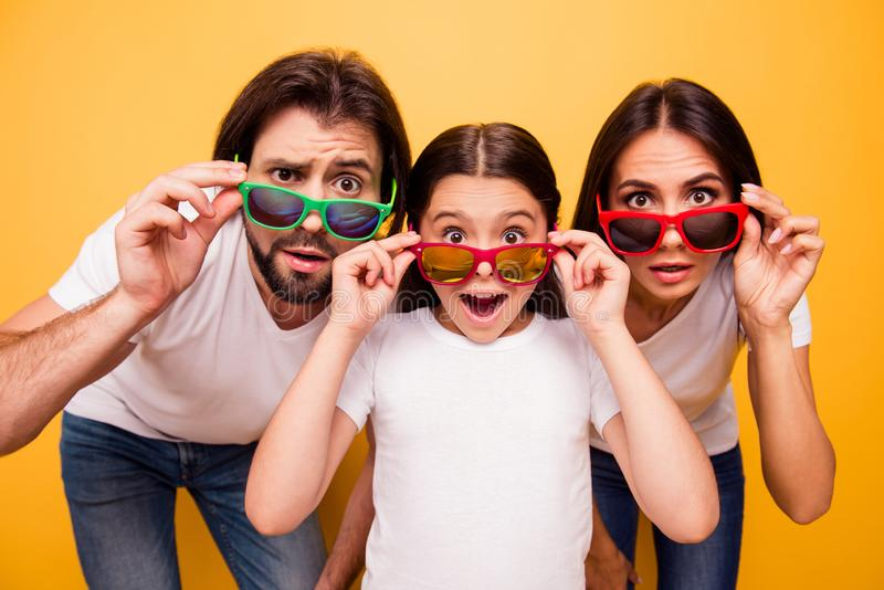 Portrait of nice lovely attractive cheerful amazed people having fun day wearing colorful modern eyewear omg gesture. Over shine vivid pastel yellow background royalty free stock photography