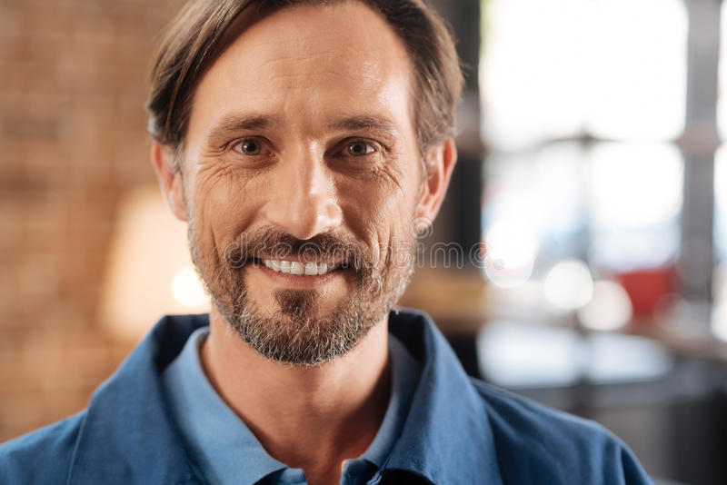 Portrait of nice optimistic courier royalty free stock image