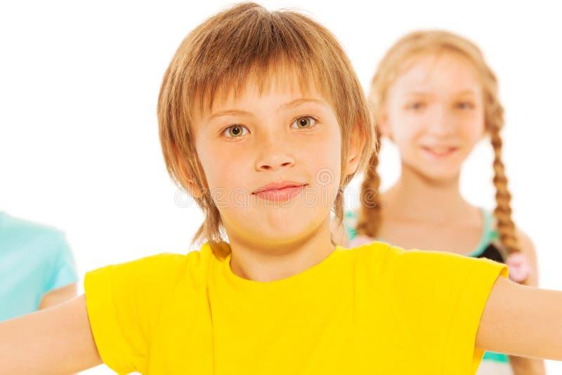 Portrait of nice school boy in yellow t-shirt stock images