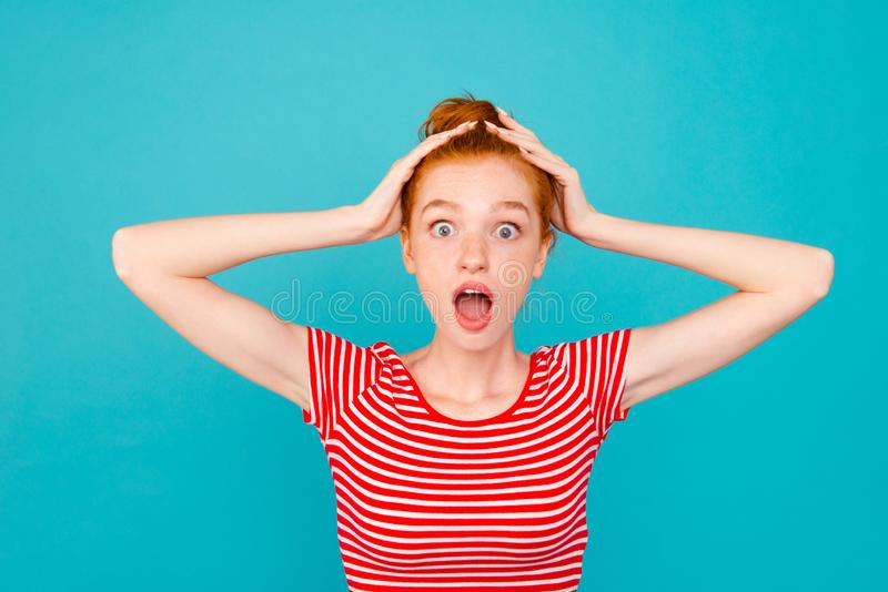 Portrait of nice shocked puzzled overwhelmed pretty red-haired g royalty free stock image