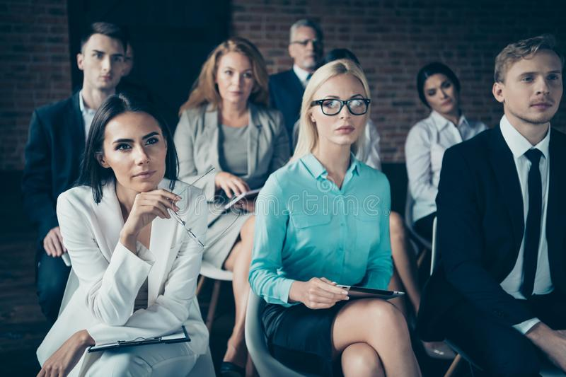 Portrait of nice stylish elegant serious focused concentrated top sharks sitting listening to ceo boss chief attending. Educative class course at industrial royalty free stock images