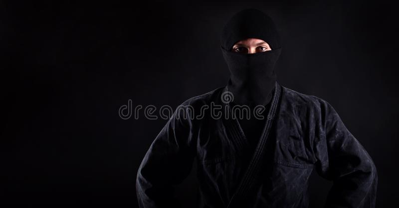 Portrait of ninja samurai with blue caucasian eyes royalty free stock images