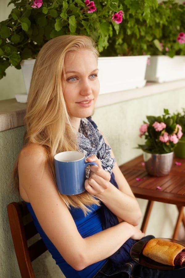 Portrait of nordic woman drinking tea. Portrait of attractive nordic woman drinking tea outdoors stock image