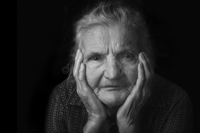 Portrait of a nostalgic elderly woman. Evoking the past. stock photos