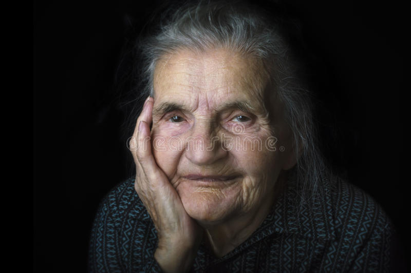 Portrait of a nostalgic elderly woman. Evoking the past. royalty free stock image