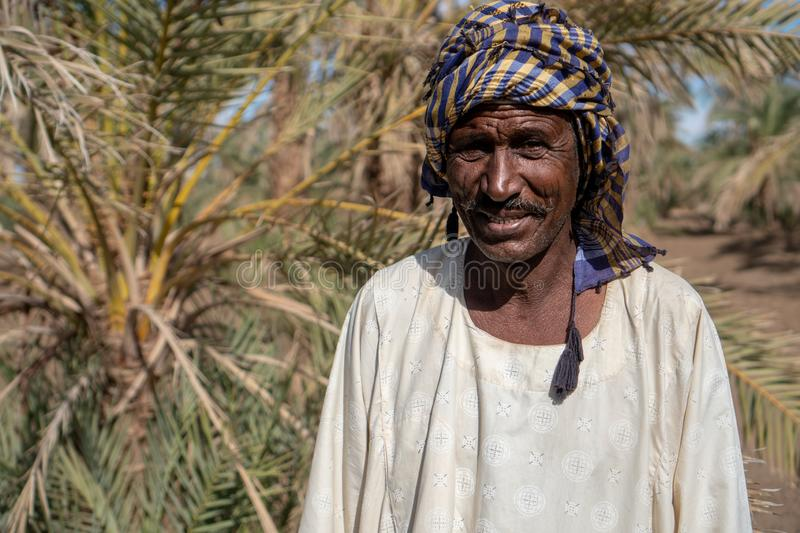 Portrait of a Nubian farmer in Abri, Sudan - Nov 2018. This man was working on his field and gave me some of his  dates to try stock photo