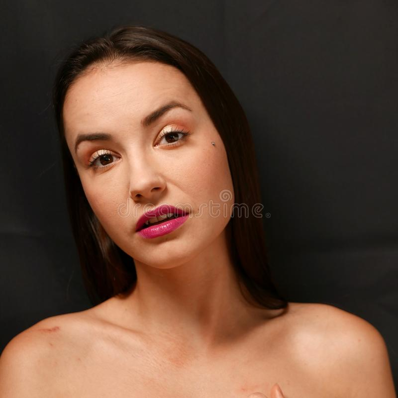 Portrait nude girl sitting on bed royalty free stock photo