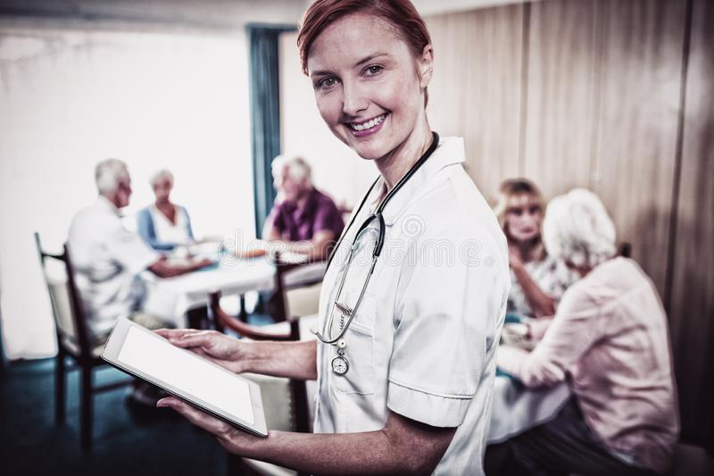 Portrait of a nurse with digital tablet stock images