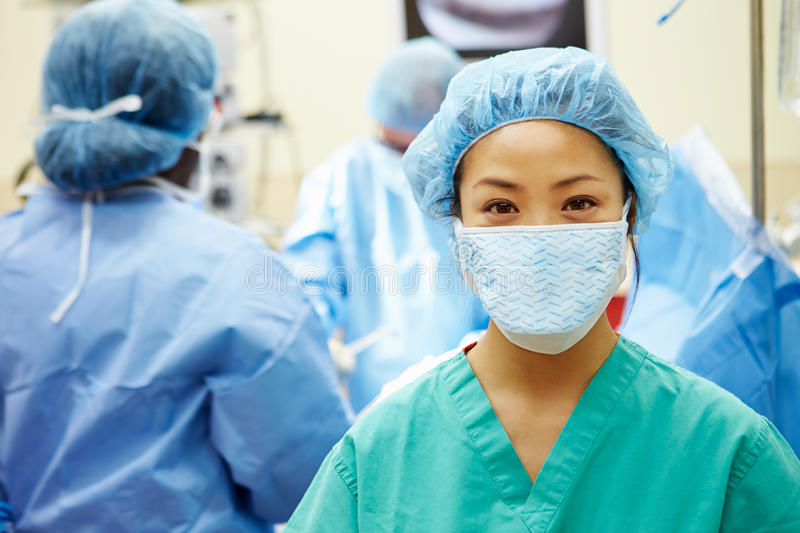 Portrait Of Nurse Working In Operating Theatre stock images