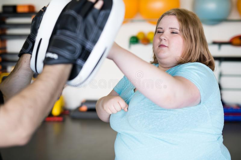 Obese Woman in Boxing Practice stock photography