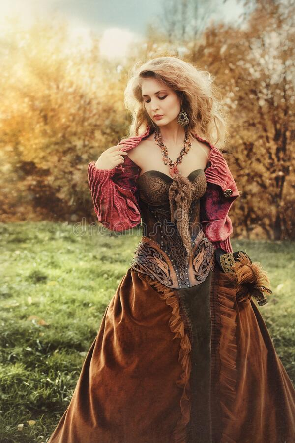 Free Portrait Of A Beautiful Blonde Woman In A Historical Costume In Nature, Royalty Free Stock Photo - 199917655