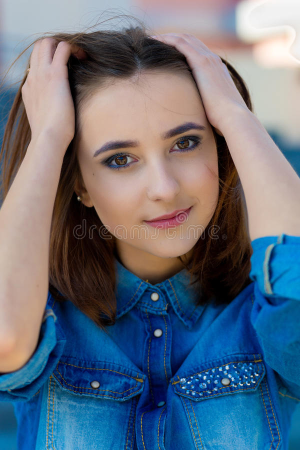 Free Portrait Of A Beautiful Girl In Blue On Stairs Stock Photos - 77666003