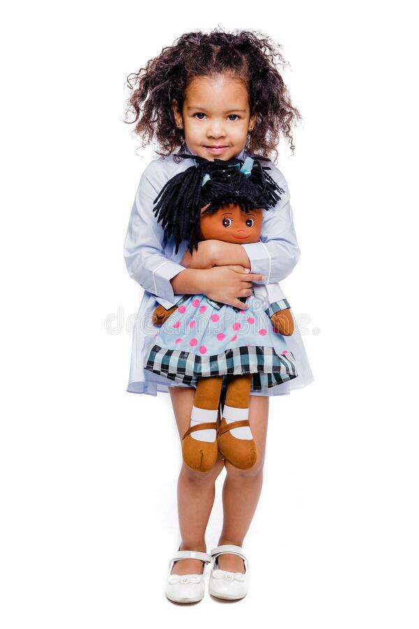 Free Portrait Of A Cute Little African American Girl Hugging Doll, Isolated On White Background Stock Photos - 193279803