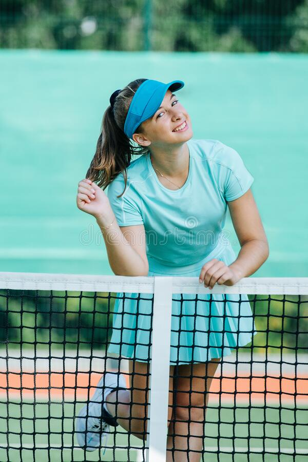 Free Portrait Of A Cute Smiling Teenage Girl Leaning On The Tennis Court Net Royalty Free Stock Image - 193741096